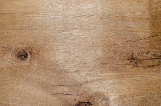 Struktura drewna, brązowy tło grunge, pęknięte deski dębowe. skopiuj miejsce