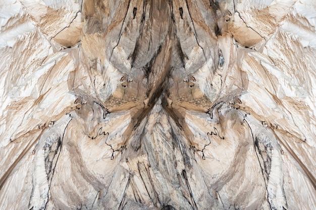 Struktura drewna z nierównym beżowym reliefem. koncepcja tło, tekstura.