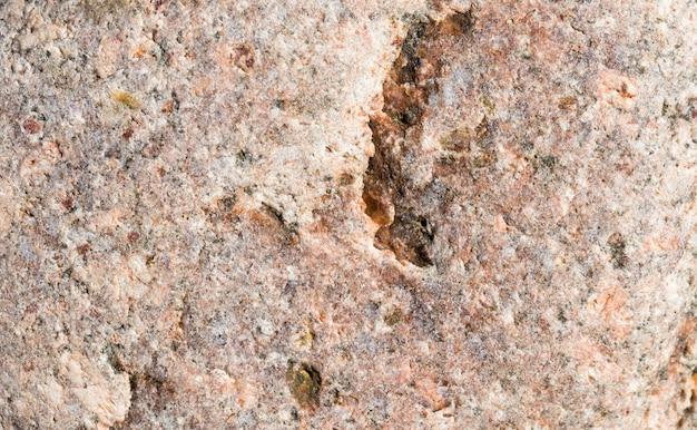 Struktura Dużego Prawdziwego Kamienia O Nierównej Szorstkiej Strukturze, Zbliżenie Materiałów Budowlanych Do Dekoracyjnego Procesu Budowlanego Premium Zdjęcia