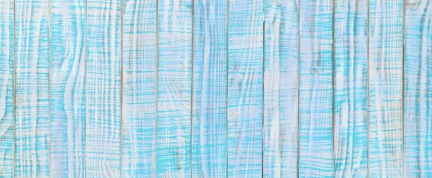 Struktura starego drewna pomalowana na kolor turkusowy lub turkusowy. jasnoniebieski drewniany stół, widok z góry