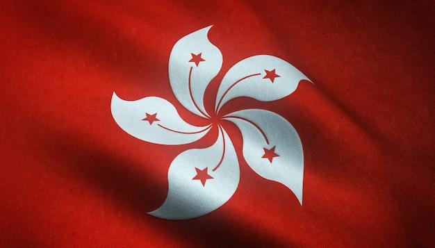Strzał zbliżenie macha flagą hongkongu z ciekawymi teksturami