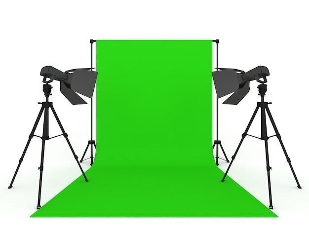 Studio fotograficzne z zielonym ekranem i lekkim sprzętem na białym tle
