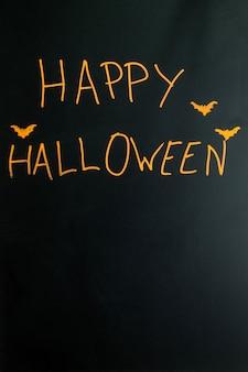 Stylizowane happy halloween podpis z nietoperzy