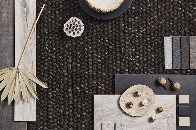 Stylowa, flat lay kompozycja moodboardu architekta z próbkami budynków, brązowych materiałów tekstylnych i naturalnych oraz osobistych akcesoriów. widok z góry, szablon.