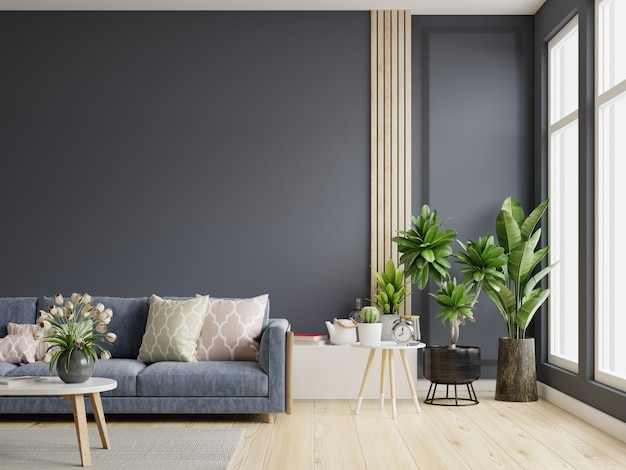 Stylowy nowoczesny drewniany salon ma ciemnoniebieską sofę na pustym ciemnoniebieskim tle ściany, renderowanie 3d