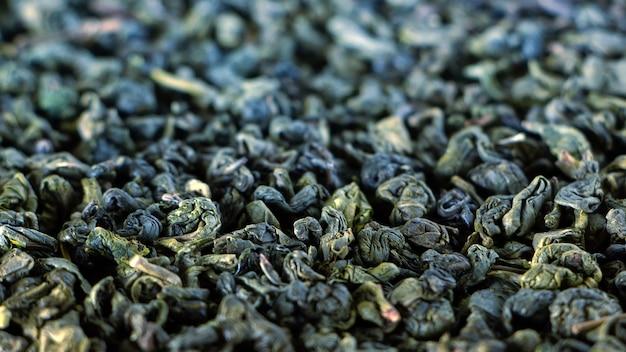 Sucha zielona herbata, tekstura. naturalne tło.