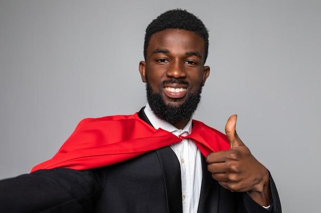 Superman afrykańskiego biznesmena wziąć selfie z kciuki do góry