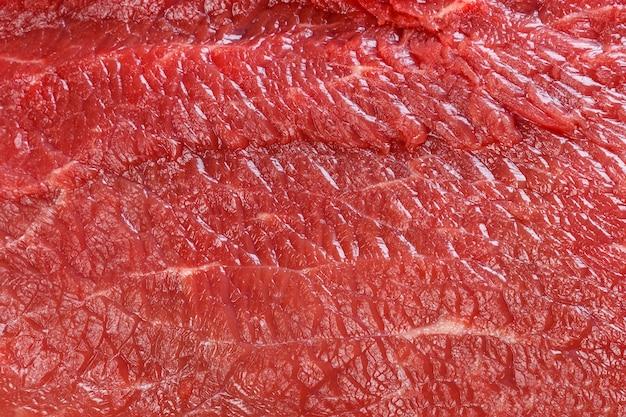Surowej czerwonej wołowiny tekstury makro- makro- tło