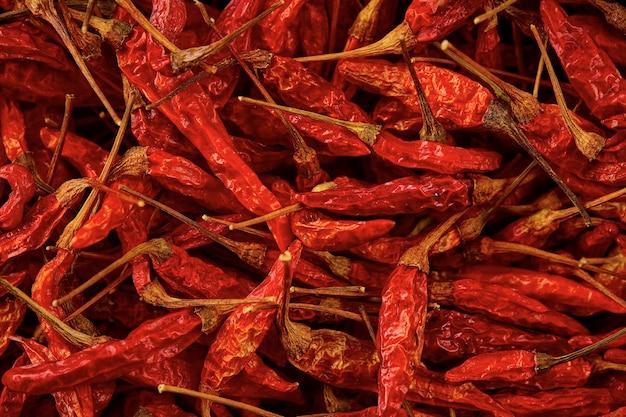 Suszone czerwone gorące chili tekstura tło, suszone czerwone chili karen jest tradycyjnym chili azji (prik ka reang)
