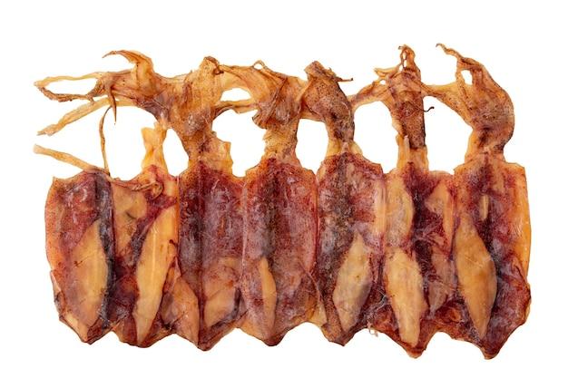 Suszone kalmary i macki ułożone w rzędzie na białym tle, przynoszenie kalmarów do wyschnięcia na słońcu, aby zachować żywność i przedłużyć czas, aby nie zepsuć kałamarnicy, sun drying food.