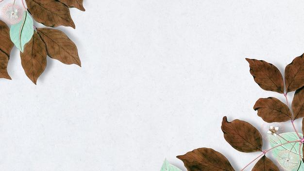 Suszone zimowe liście zdobione pustą ramką