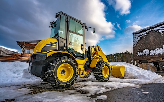 Sweep snow plough car