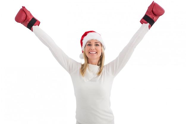 Świąteczna blondynka w rękawicach bokserskich
