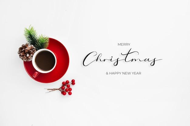 Świąteczna wiadomość powitalna z czerwoną filiżanką kawy
