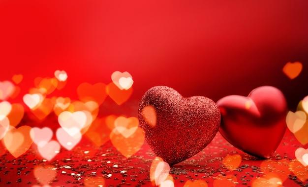 Świąteczne tło na walentynki z miejsca na kopię. dwa serca na czerwonym tle z iskierkami i bokeh w kształcie serca.