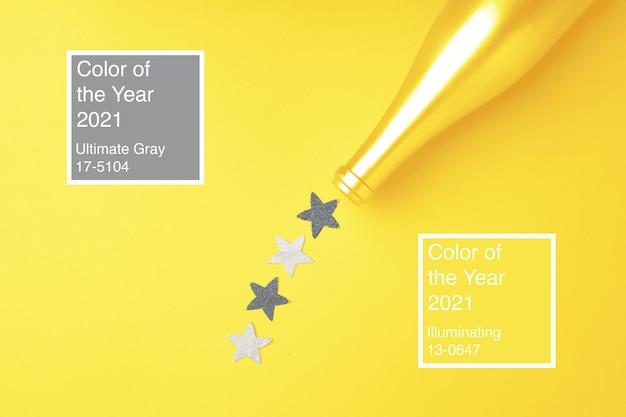 Świąteczne tło z butelką szampana i konfetti w kolorach roku 2021