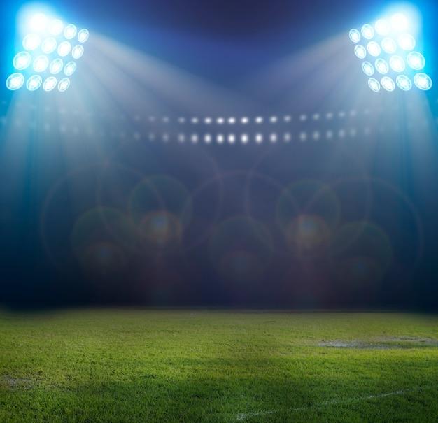 Światła w nocy i stadion piłkarski