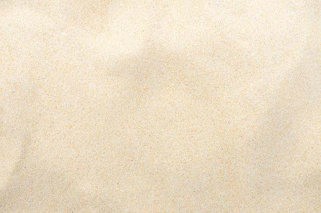 Świetny plażowy piasek w lata słońcu jako tło