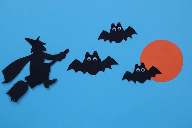 Święto halloween. kompozycja z różnymi figurami z papieru halloween na niebieskim tle