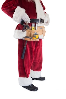 Święty mikołaj ma na sobie pas z narzędziami
