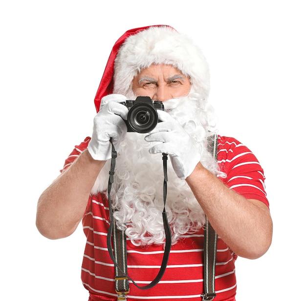 Święty mikołaj z aparatem fotograficznym na białym tle. koncepcja wakacji