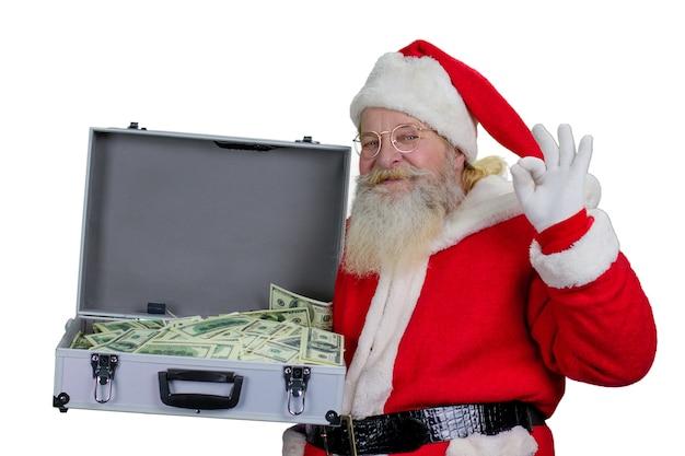 Święty mikołaj z otwartą skrzynką pełną pieniędzy.