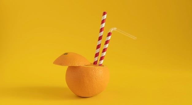 Świeża pomarańcza z kontrastowymi tubkami do picia jako źródło naturalnej witaminy c. zapobieganie koronawirusowi i innym przeziębieniom dzięki naturalnym witaminom.