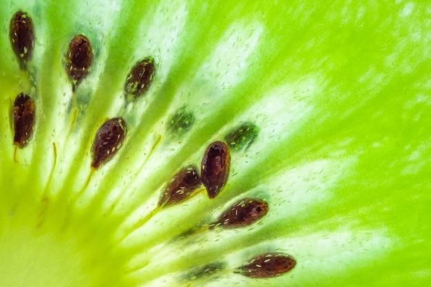 Świeże owoce kiwi plasterki zbliżenie makro tekstury tła