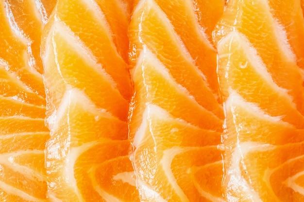 Świeżego łososia plasterek sashimi tekstury tła