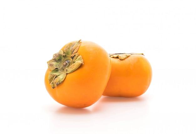 Świeży persimmon na białym tle