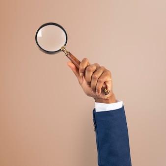 Symbol firmy badawczej szkła powiększającego