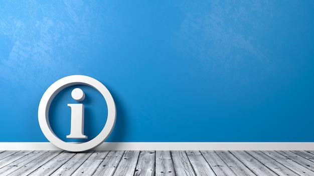 Symbol informacji na drewnianej podłodze przy ścianie