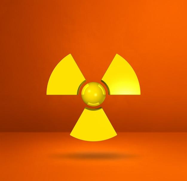 Symbol radioaktywnych na białym tle na pomarańczowym tle studio.