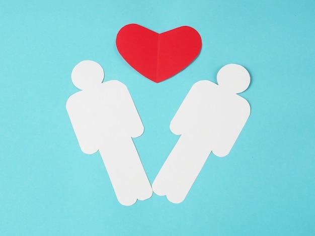 Symbol serca między symbolami dwóch osób na niebieskim tle