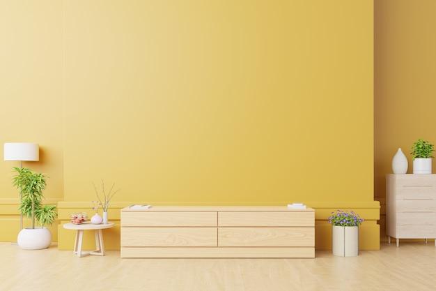 Szafka na telewizor lub umieść obiekt w nowoczesnym salonie z lampką, stołem, kwiatkiem i rośliną na żółtej ścianie.