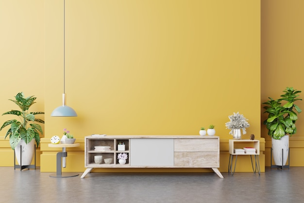 Szafka rtv w nowoczesnym salonie z lampką, stołem, kwiatkiem i rośliną na żółtej ścianie. renderowanie 3d