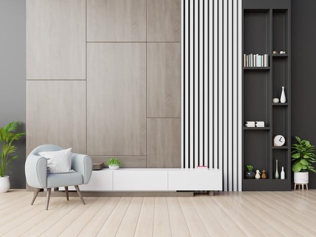 Szafka tv w nowoczesnym salonie z fotelem na drewnianej ścianie.