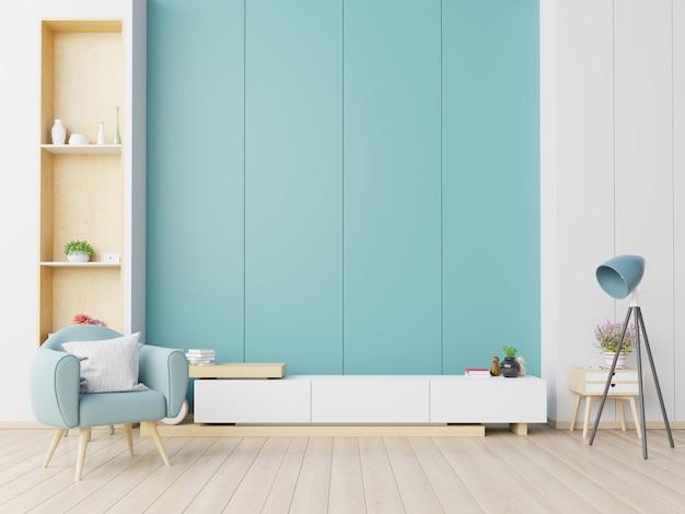 Szafka tv w nowoczesnym salonie z fotelem na niebieskiej ścianie.