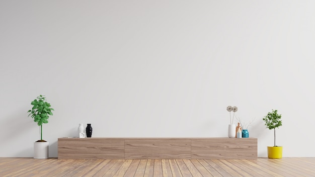 Szafka w nowoczesnym pustym pokoju, biała ściana.