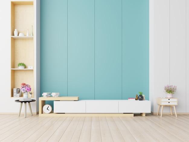 Szafki i ściana do telewizora w salonie, niebieskie ściany.