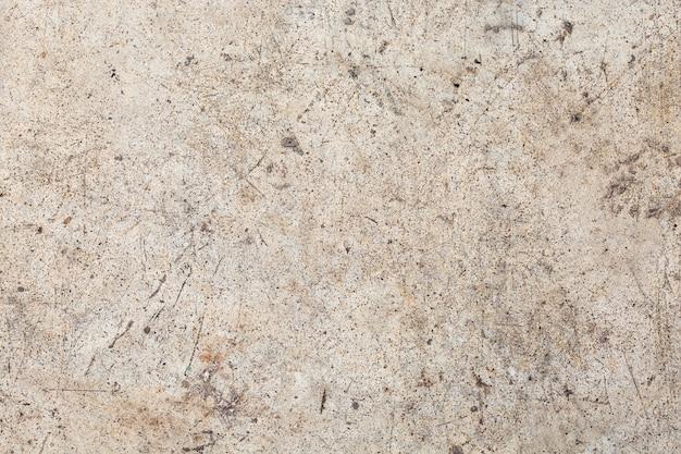 Szara betonowa ściana na tle