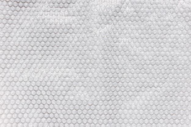 Szara folia bąbelkowa do pakowania, tekstura tło
