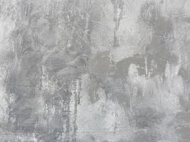 Szara gładka ściana z szorstkim wykończeniem