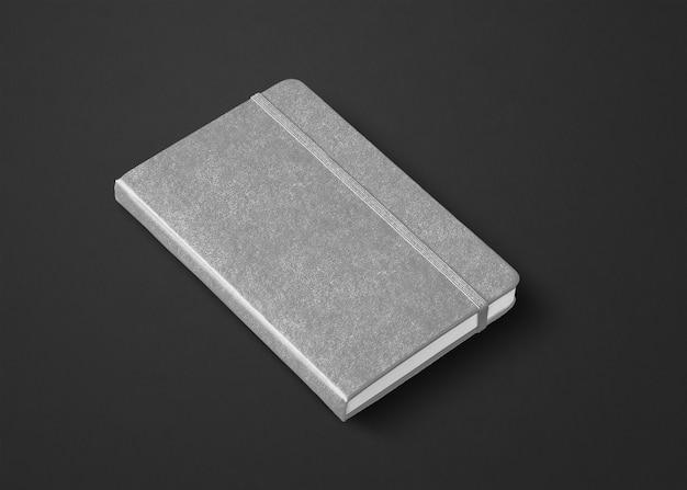 Szara makieta zamkniętego notebooka na czarnym tle
