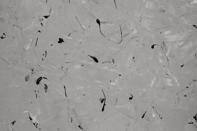 Szara piękna abstrakcyjna powierzchnia z czarną farbą.