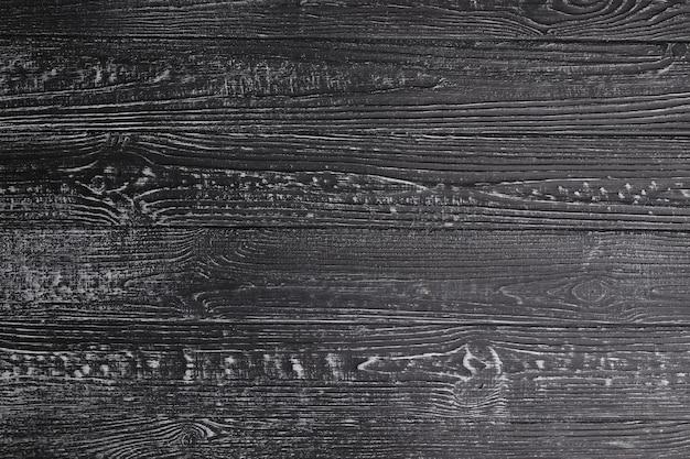 Szara porysowana drewniana deska do krojenia. tekstura drewna. puste drewniane.