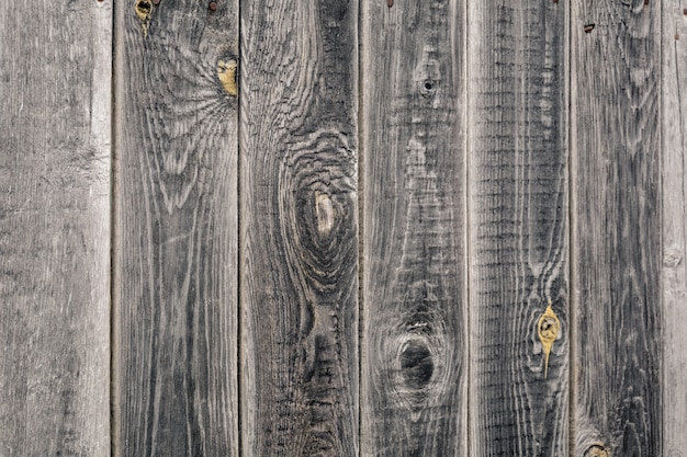 Szara ściana drewniana ze starych desek sosnowych