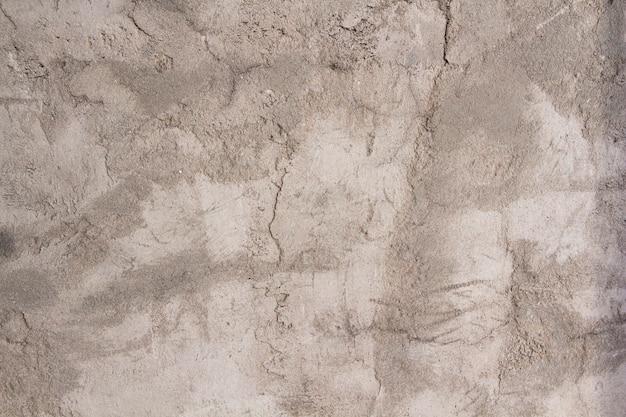 Szara tekstura tynku betonowego. szorstka biało-szara ściana.
