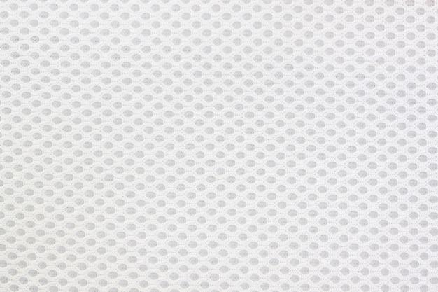 Szara wzorzysta tkanina na tle.