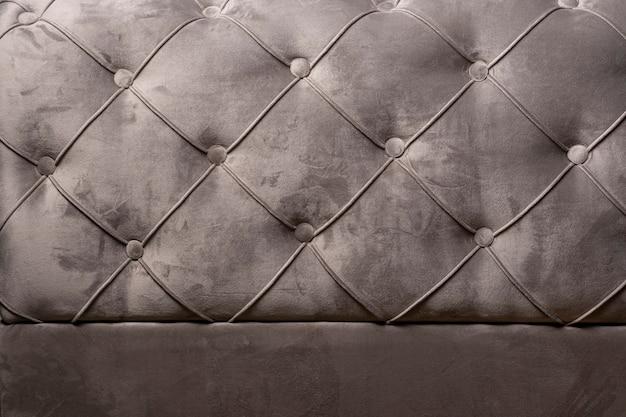 Szare aksamitne tekstury tła sofy z zatopionymi guzikami aksamitnej tekstury
